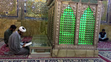 vallási : Shirahz, Iran - 2019-04-09 - Shah Cheraugh Temple Mirror Tomb 2 - Praying. Stock mozgókép