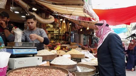 店員 : Amman, Jordan - 2019-04-18 - Man Buys Nuts From Market Bazaar.