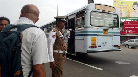 direkt : Colombo, Sri Lanka - 2019-03-21 - Traffic Cop Controls Cars for Pedestrians.