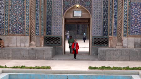 persie : Kerman, Iran - 2019-04-06 - Woman in Red Comes Out of Ganjali Mosque.