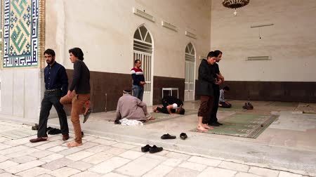 ladrillo : Kerman, Iran - 2019-04-06 - Muslim Men Remove Their Shoes and Pray in Ganjali Mosque 1.