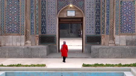 khan : Kerman, Iran - 2019-04-06 - Woman in Red Enters Ganjali Mosque.