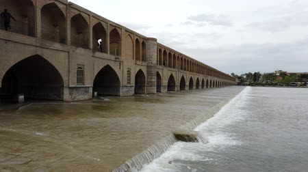 local de interesse : Isfahan, Iran - 2019-04-12 - Si-o-se-pol Bridge is Most Famous in Town 2 - Daytime Downstream Closeup. Stock Footage