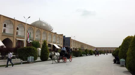 lő : Isfahan, Iran - 2019-04-12 - Horse Carriage Ride Around Naqshe Cehan Square 2 - Two Carriages Follow.