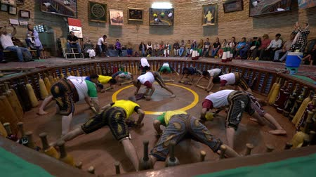yazd : Yazd, Iran - 2019-04-10 - Zurchane Wrestling Team Excercises In Front of Audience Doing Complex Pushups.