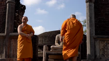 дзен : Polonnaruwa, Sri Lanka - 2019-03-23 - Monks On Tour 8 - Up Stairs Past Buddha Statue.