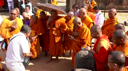 mantra : Polonnaruwa, Sri Lanka - 2019-03-23 - Monks On Tour 6 - Studying Bas Relief on Ground. Stock Footage