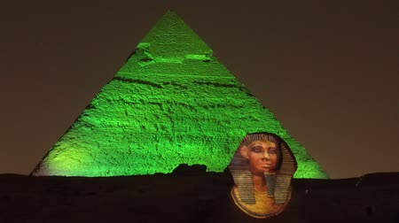 triângulo : Cairo, Egypt - 2019-05-03 - Pyramid Light Show - Sphinx Becomes Illuminated. Stock Footage