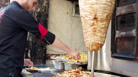 kebab : Cairo, Egypt - 2019-05-03 - Shawarma With Fries Made by Street Vendor. Stock Footage