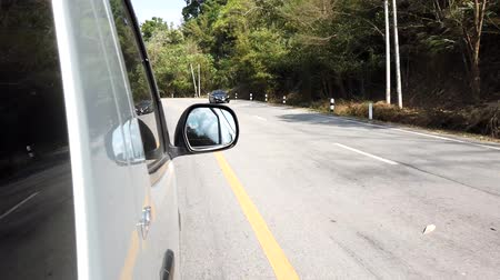 driveway : Phayao, Thailand - 2019-03-08 - Car Drives on Thailand Curvy Road.