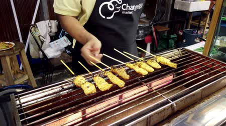 kebab : Chiang Mai, Thailand - 2019-03-15 - Chicken Sticks Are Rotated On Stove In Market.