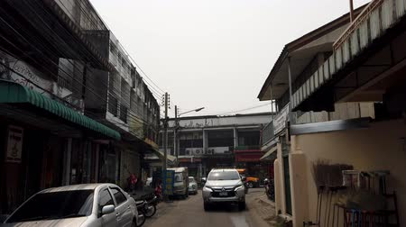 adil : Chiang Mai, Thailand - 2019-03-15 - Car Drives Down Small Street As Seen From Front.