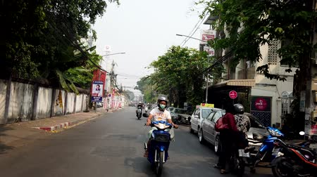 adil : Chiang Mai, Thailand - 2019-03-15 - Motorcyles Drive Down Small Street As Seen From Front.