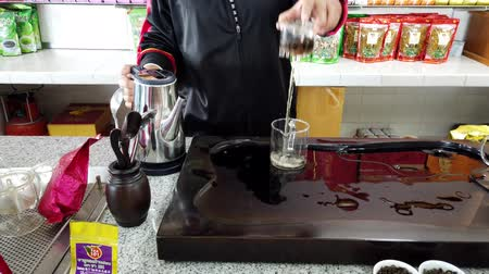 oryantal : Mae Saiong. Thailand - 2019-03-11 - Woman Shows How to Make Tea - Trash First Pour.