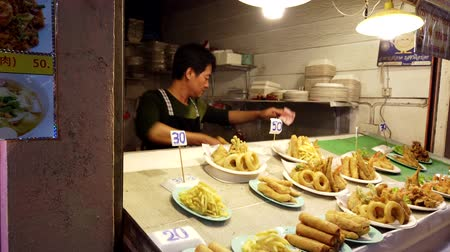 night life : Chiang Rae, Thailand - 2019-03-13 - Food Vendor at Market Specializes in Deep Fried. Stock Footage