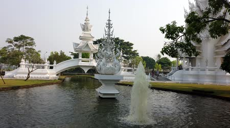 sagrado : Chiang Rae, Thailand - 2019-03-13 - White Temple - Fountain and Bridge.