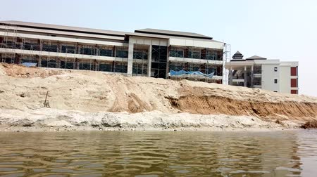 sagrado : Chiang Rae, Thailand - 2019-03-13 - Long Boat on River - Passing Hotel Under Construction.