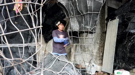 ruhanilik : Chiang Rae, Thailand - 2019-03-13 - White Temple Construction - Man Prepares Wire Cave For New Shrine.