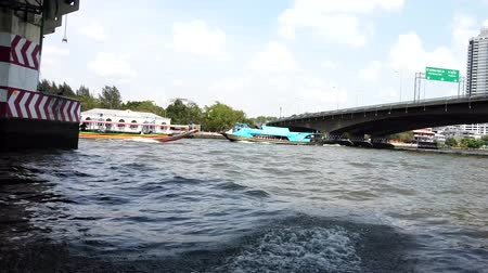 water taxi : Bangkok, Thailand - 2019-03-03 - Speeding Canal Boat Seen From Another Boat.
