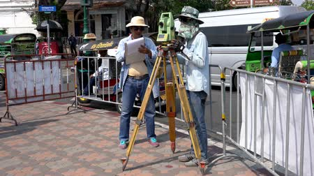 field measurements : Bangkok, Thailand - 2019-03-02 - Two Men Measure Plot Lines For New Construction - Close View.