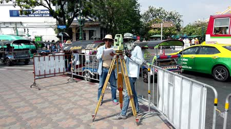 field measurements : Bangkok, Thailand - 2019-03-02 - Two Men Measure Plot Lines For New Construction - Wide View.