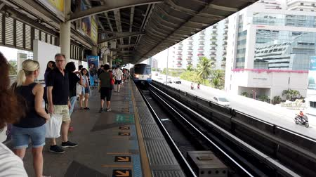 rapid transit : Bangkok, Thailand - 2019-03-03 - Commuter Train Arrives in Station.