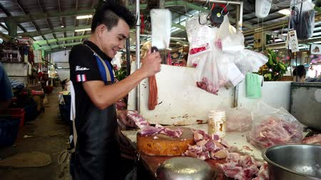dead chickens : Bangkok, Thailand - 2019-03-17 - Market Vendor Hacks Meat For Sale.