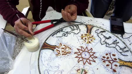 vleermuis : Petra, Jordan - 2019-04-20 - Mosaic 6 - Artists Glues Pieces for Circular Plaque.