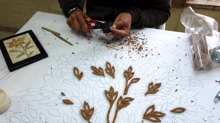 プラーク : Petra, Jordan - 2019-04-20 - Mosaic 1 - Artists Glues Pieces for Flower Plaque.