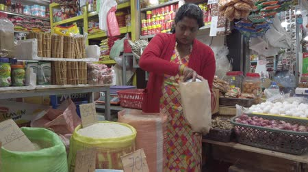 Nuware, Sri Lanka - 2019-03-27 - Vendor Measures Out Rice For Sale.