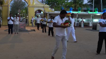 tojás : Kataragama, Sri Lanka - 2019-03-29 - Men Enter Temple Grounds With Offerings of Food.