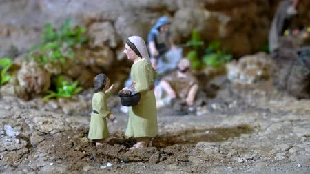 divino : Cuenca, Ecuador - 2019-01-03 - Animated Christmas Nativity Scene - Woman Talks To Boy. Stock Footage