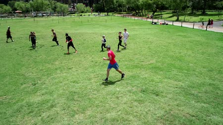 crouch : Cuenca, Ecuador - 2019-02-10 - Pickup Extreme Frisbee in Park - Aerial View Blocked Pass.