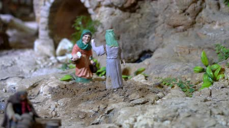 vallási : Cuenca, Ecuador - 2019-01-03 - Animated Christmas Nativity Scene - Two Women Talk. Stock mozgókép