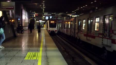 dividing : Valparaiso, Chile - 2019-07-13 - Slow Motion Two Subway Trains Pull Into Station. Stock Footage