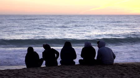 Vina del Mar, Chile - 2019-07-18 - Five Friends Sit on Beach Watching Sun Set.