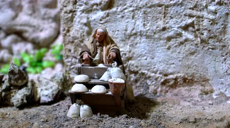 virgem : Cuenca, Ecuador - 2019-01-03 - Animated Christmas Nativity Scene - Woman Kneeds Dough For Bread.