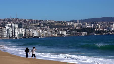 Vina del Mar, Chile - 2019-07-28 - Young Couple Wanders into the Surf. Wideo