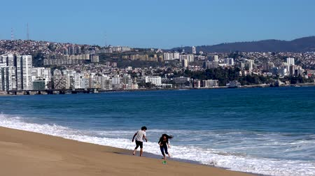 Vina del Mar, Chile - 2019-07-28 - Young Couple Runs From the Surf.