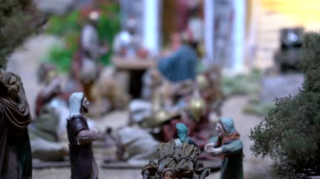 divino : Cuenca, Ecuador - 2019-01-03 - Animated Christmas Nativity Scene - Soldiers Play Dice. Stock Footage