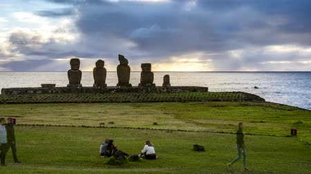 People Wait For Sunset in Front of Moai on Easter Island. Stock Footage