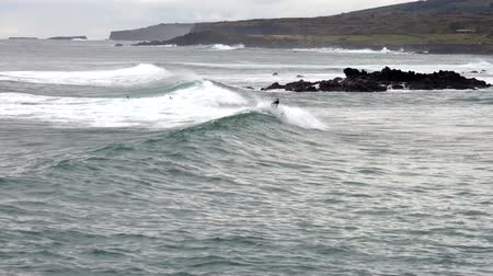 Surfer Rides Long Wave on Easter Island.