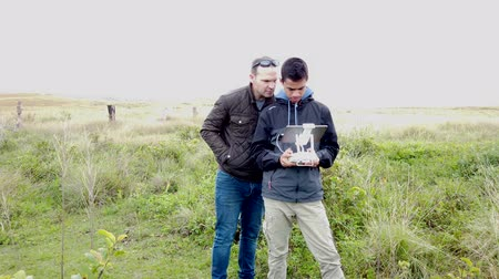 Father and Son Learn To Fly a Drone in Easter Island.