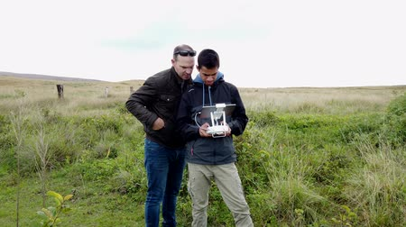 işlemek : Father Teaches Son How To Fly a Drone in Easter Island. Stok Video