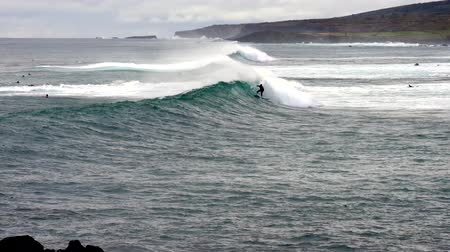 Surfer Rides Wave on Easter Island.