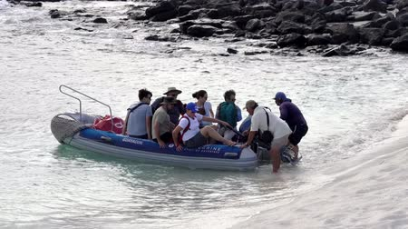 Galapagos, Ecuador - 2019-06-20 - Tourist landing boat arrives at beach.