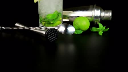 fodormenta : Mojito cocktail with fresh limes, mint and ice cubes, bar tools