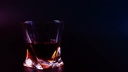nightcap : Mans drinking whiskey on black background