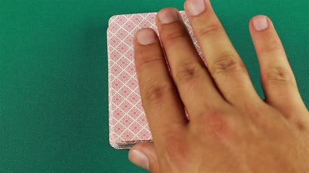 coringa : Ace on top of a pack of cards.