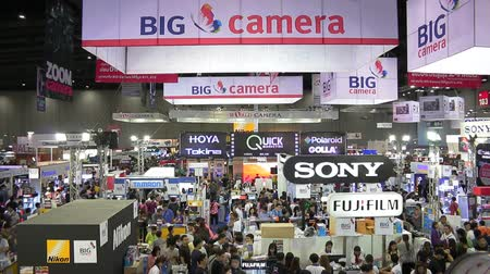 all ages : Bangkok, Thailand - November 29, 2015:People all of ages visiting and buy the camera or accessories for photography in Photo Fair 2015 Between 25-29 November 2015 at BITEC in Bangkok, Thailand